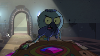 S2E35 Ludo pointing at the book of spells