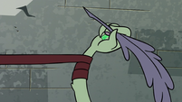 S3E3 Book of Spells catches Ludo's arm with ribbon