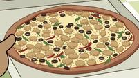 S2E24 Emilio holding Marco's mushroom pizza