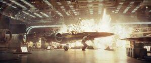 Star-wars-the-last-jedi-trailer-15-poe-hangar-explosion-700x293