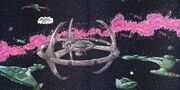 Deep Space 9 surrounded by Klingons