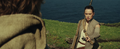 Rey hands Luke Skywalker his old lightsaber.png