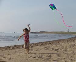 File:A girl flying a kite.jpg