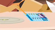 S1 E16 Emma uses Mr. Marvin's hand to sign her evaluation form from right to left
