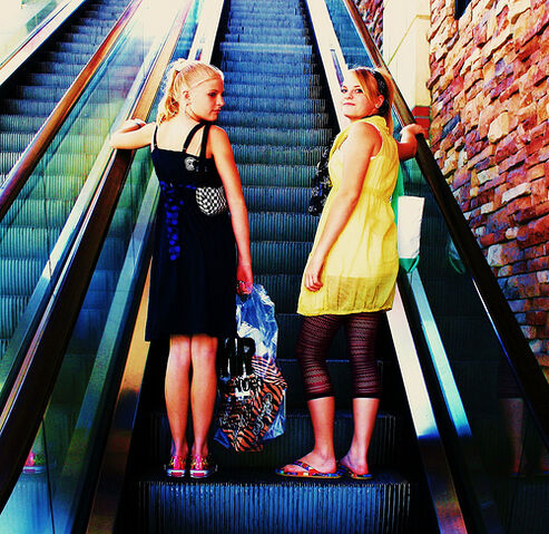 File:Free Mall Girls Riding on The Escalator Creative Commons.jpg