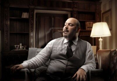 7173136-fat-man-sitting-on-an-armchair-and-smoking-a-cigar