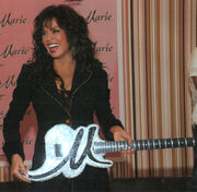 Marie osmond with guitar
