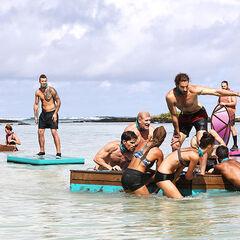 Mark H. helps pull Samatau's coconut raft.