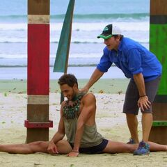 Reed falls over after winning immunity.