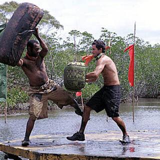 Edgardo pushes Earl into the mud.