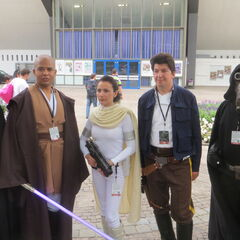 Fans dressed as Sith, Mace Windu, Padme Amidala, and Han Solo.