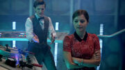 Clara and Eleventh Doctor around TARDIS console Journey to the Centre of the TARDIS