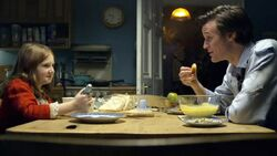 The Doctor and Amelia in kitchen
