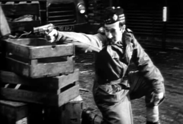 File:Web of Fear Colonel shoots at yeti.jpg