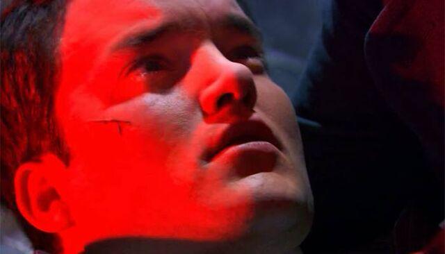 File:Ianto dying on jacks arms.jpg