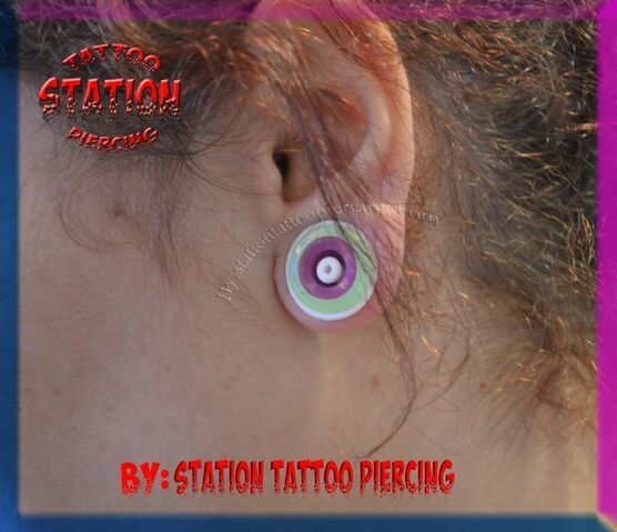 File:Piercing, tunnel, multible, streching, station, female, lobe, tattoo, silicone tunnels, cyprus, studio,.JPG