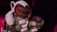 Raphael Admiring A Newborn Alien Turtle