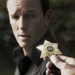 Sheriff gets badge back