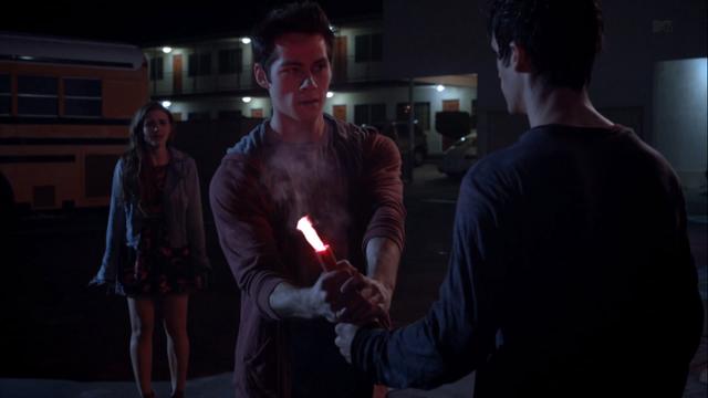 File:Teen Wolf Season 3 Episode 6 Motel California Holland Roden Dylan O'Brien Tyler Posey Lydia Stiles saves Scott.png