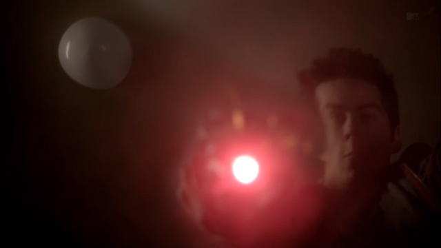 File:Teen Wolf Season 3 Episode 6 Motel California Dylan O'Brien Stiles with Road Flare under water.png