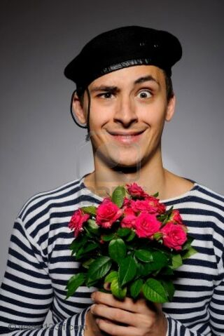 File:7887006-funny-emotional-romantic-sailor-man-holding-rose-flowers-prepared-for-a-date.jpg