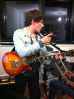 Brad Kavanagh on guitar