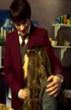 Nina sad Fabian holding her head