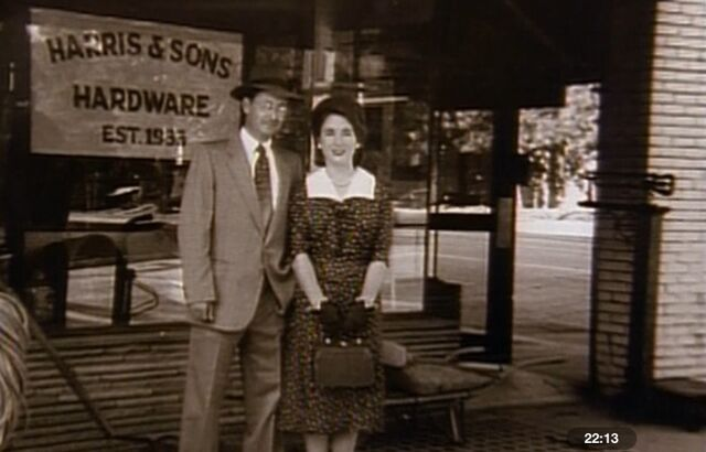 File:Mr. & mrs Harris next to the hardware store .jpg