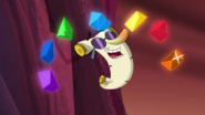 S1e24 colored gems around singing scroll