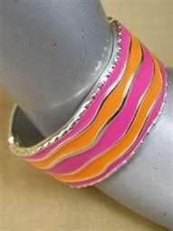 File:Marigold Summer's District Token (Orange, Pink & Silver Bangle).jpg