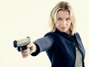 Eve Baird pointing gun season 1 promotional