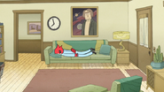 S6E25.009 Margaret Laying Face Down on the Couch