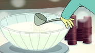 S6E10.162 Some Guy Making a Ladle Fly