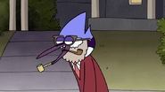 S3E04.205 Mordecai Talking in His Dad Costume