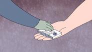 S4E23.068 Muscle Man Giving Donny G the Cassette