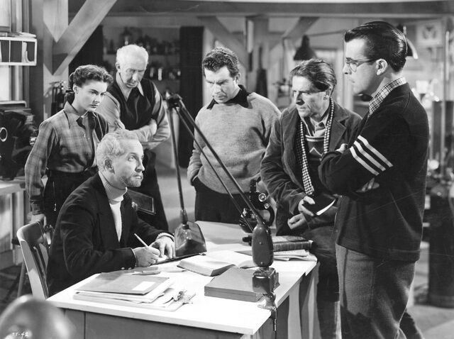 File:The scientists discuss Carrington's experiment - The Thing (1951).jpg