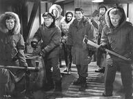 The men confront The Thing in the basement - The Thing (1951)