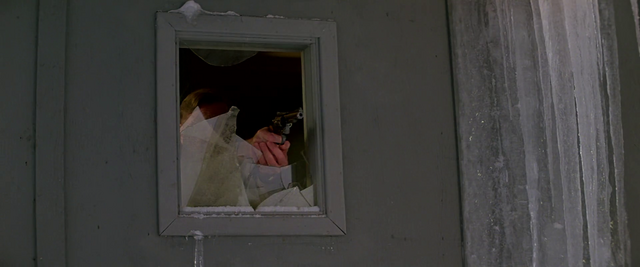 File:Garry shoots the Norwegian through the window -The Thing (1982).png.png