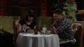 Noah smiles as Tessa examines her food