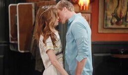 Travis kisses Victoria
