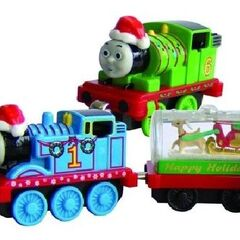 Santa Thomas and Percy with snow globe