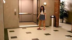 Jess chasing nick around the elevator