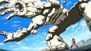 Toriko using Kugi Punch on Rock Drum's arm