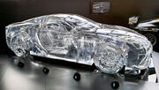 Translucent glass model in the shape of a coupe.