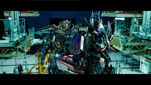 File:Dotm-sentinelprime&optimusprime-film-nestbase.jpg