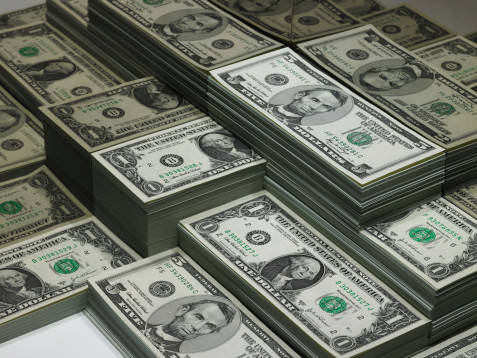 File:Saving-money-tips-stacks-of-dollars-cash.jpg
