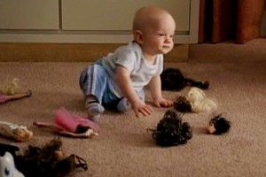 File:Baby-with-barbie-doll-heads.jpg