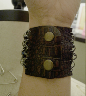 Armor-jewelry-red-brown-leather-with-metal-details-cuff-for-hbos-true-blood-profile