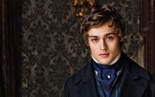 Douglas-Booth-Romeo-And-Juliet-Hairstyle-2015-915x572