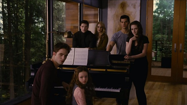 File:Renesmee cullen playing piano nessie music twiligh saga breaking dawn part 2 movie with family and friend Jacob Black .jpg